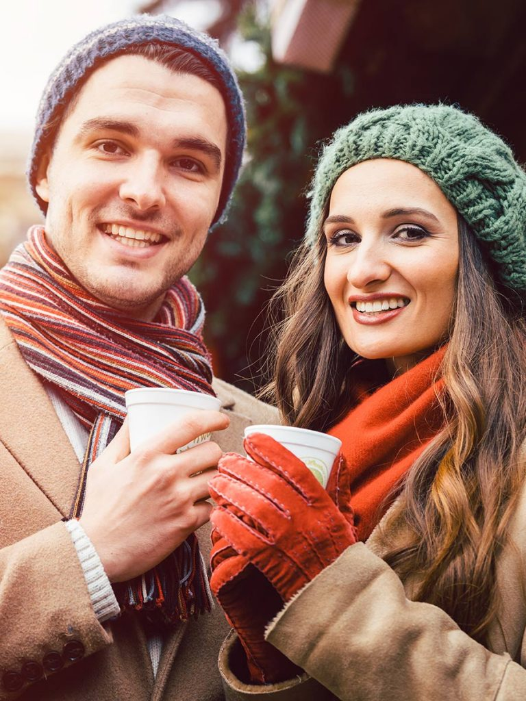 Couple has a sensual date at the Christmas market
