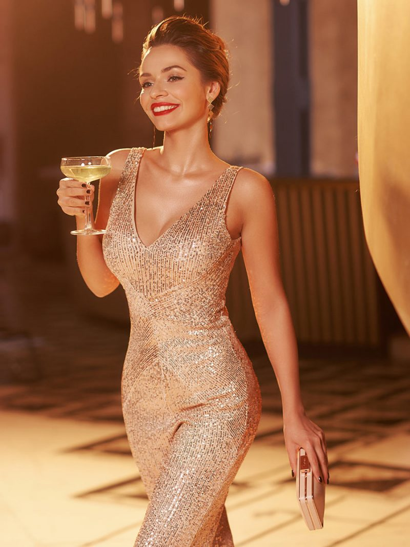 Stylish young woman enjoys her champagne