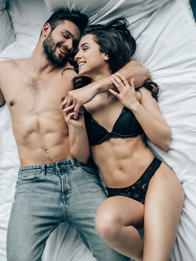 Couple enjoys hot date in bed