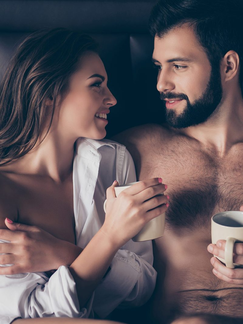 Couple enjoys the morning together in bed