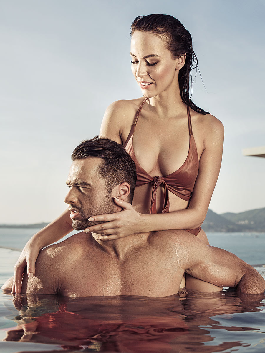 Couple gets closer on a hot date in the pool